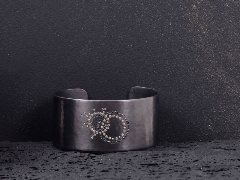 Cosmic collision cuff bracelet