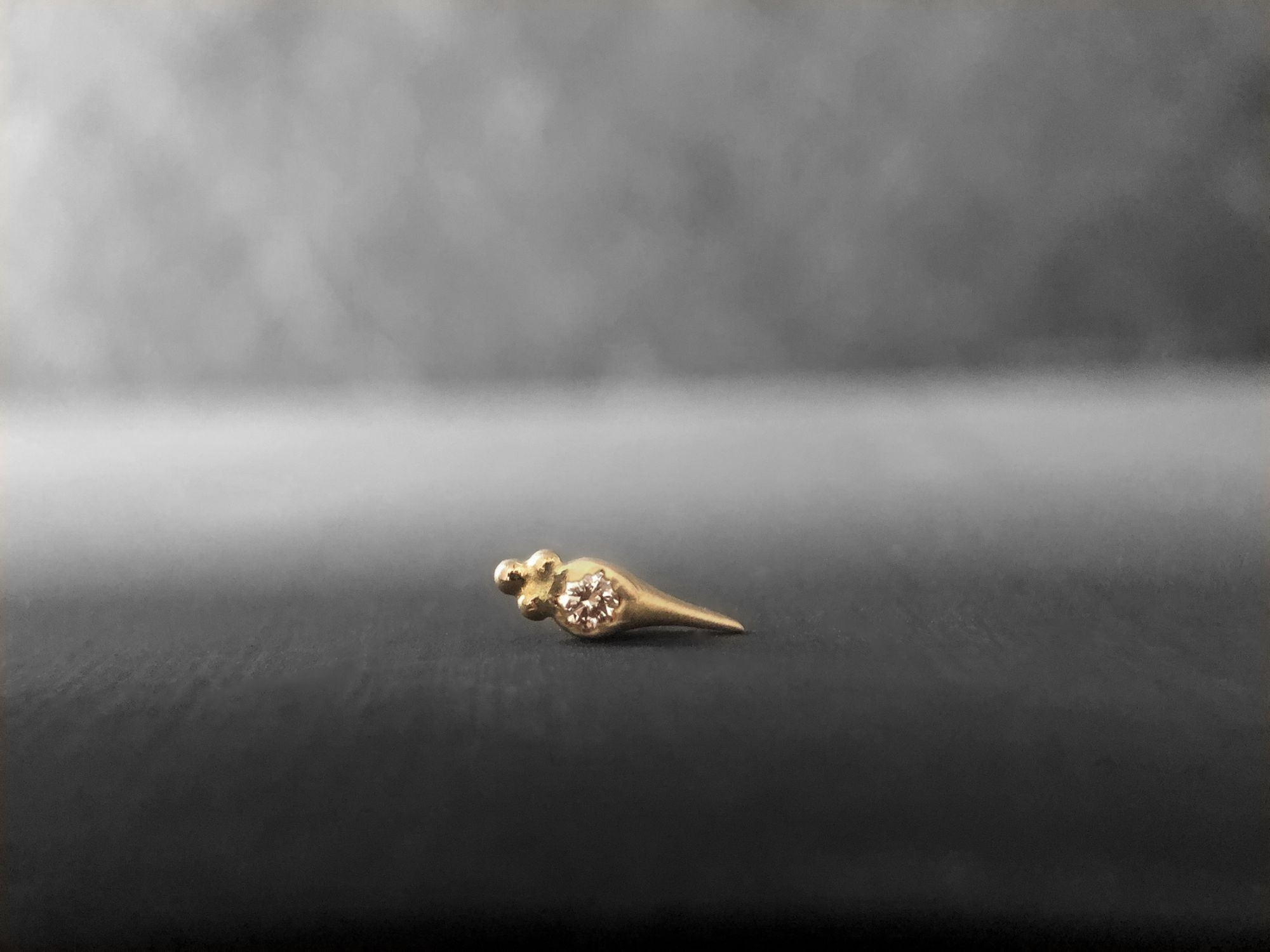 Round Sword honey diamond stud earring by Emmanuelle Zysman