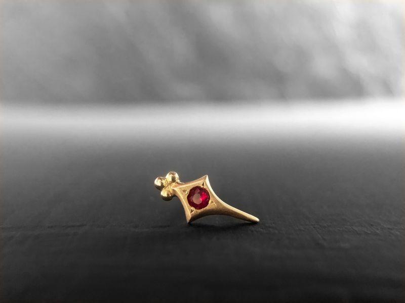 Sword ruby stud earring by Emmanuelle Zysman
