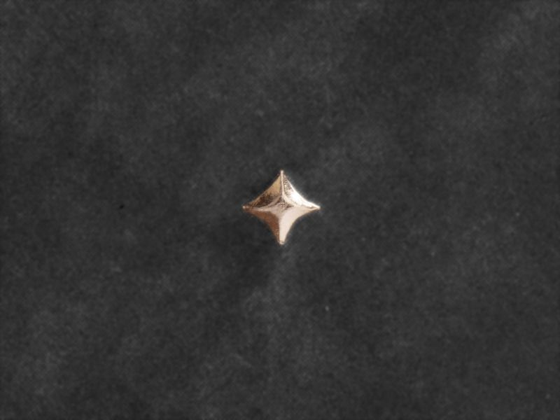 Star mini-stud earring by Emmanuelle Zysman