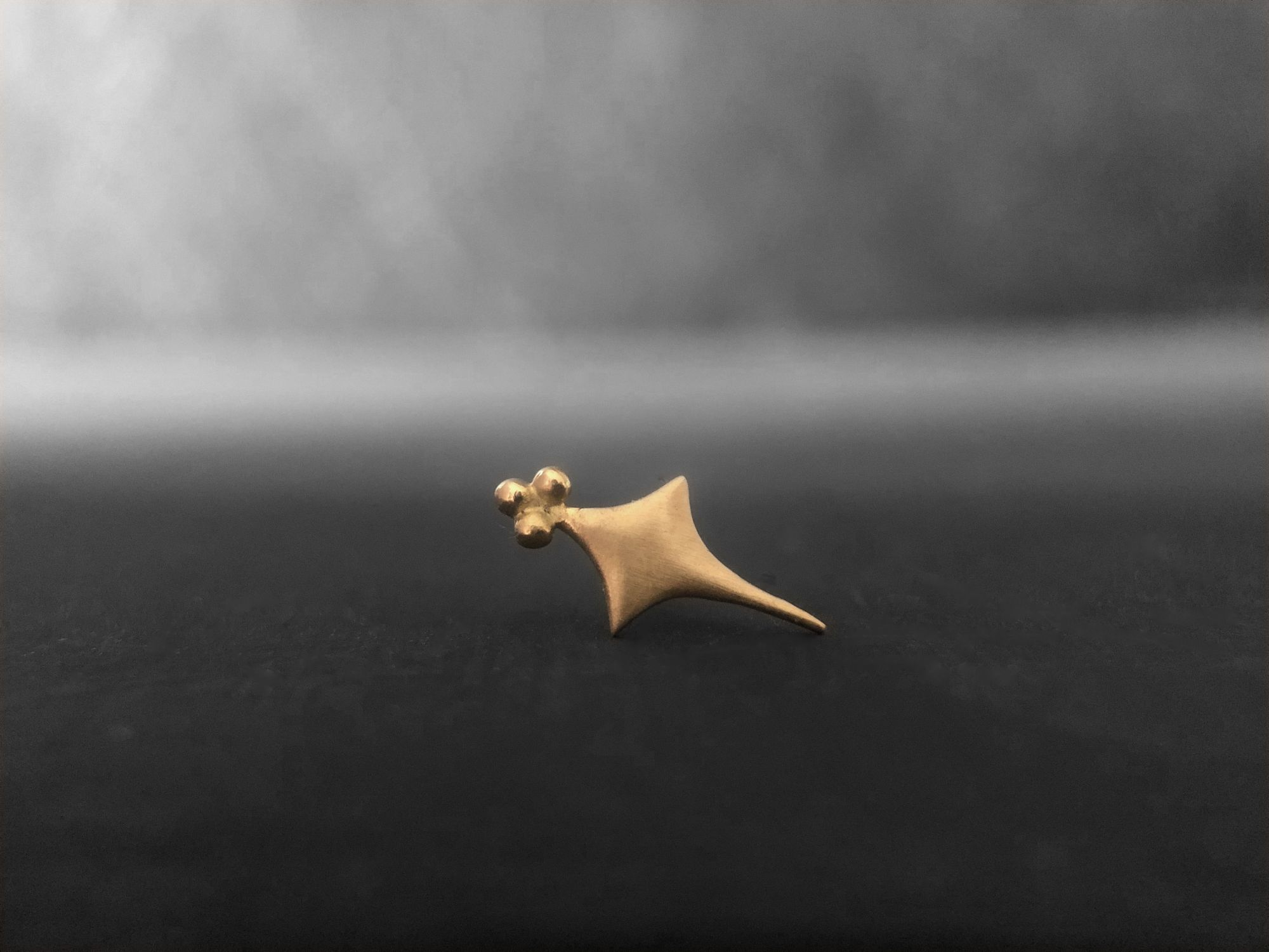 Sword yellow gold stud earring by Emmanuelle Zysman