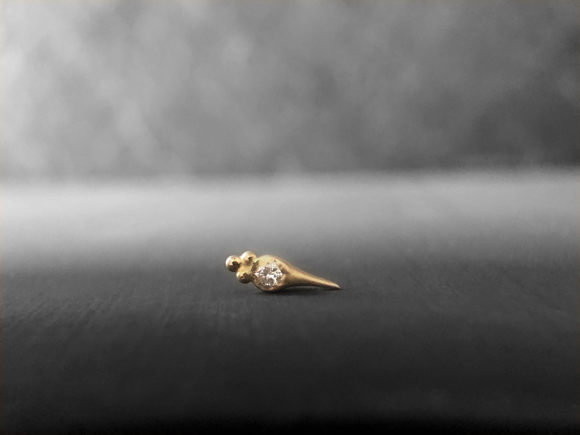 Round Sword diamond stud earring by Emmanuelle Zysman