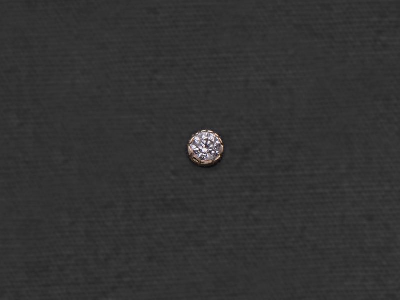 Diamond stud earring by Emmanuelle Zysman