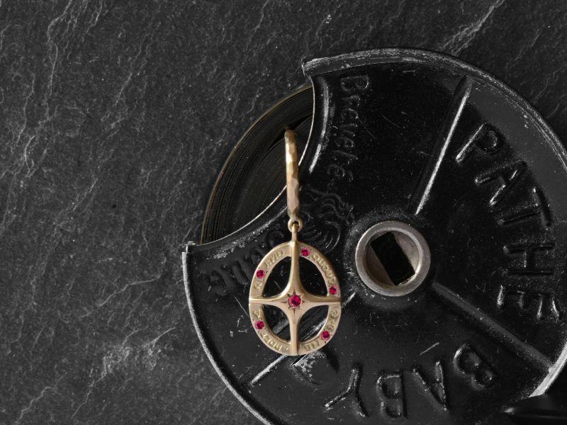 Amo Quod ruby hoop earring by Emmanuelle Zysman