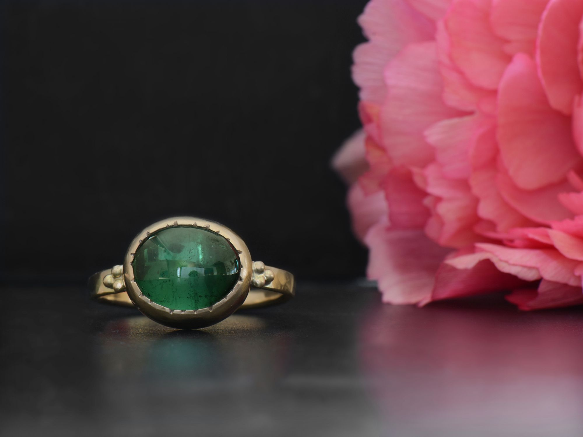 Queen B yellow gold and oval green tourmaline ring by Emmanuelle Zysman