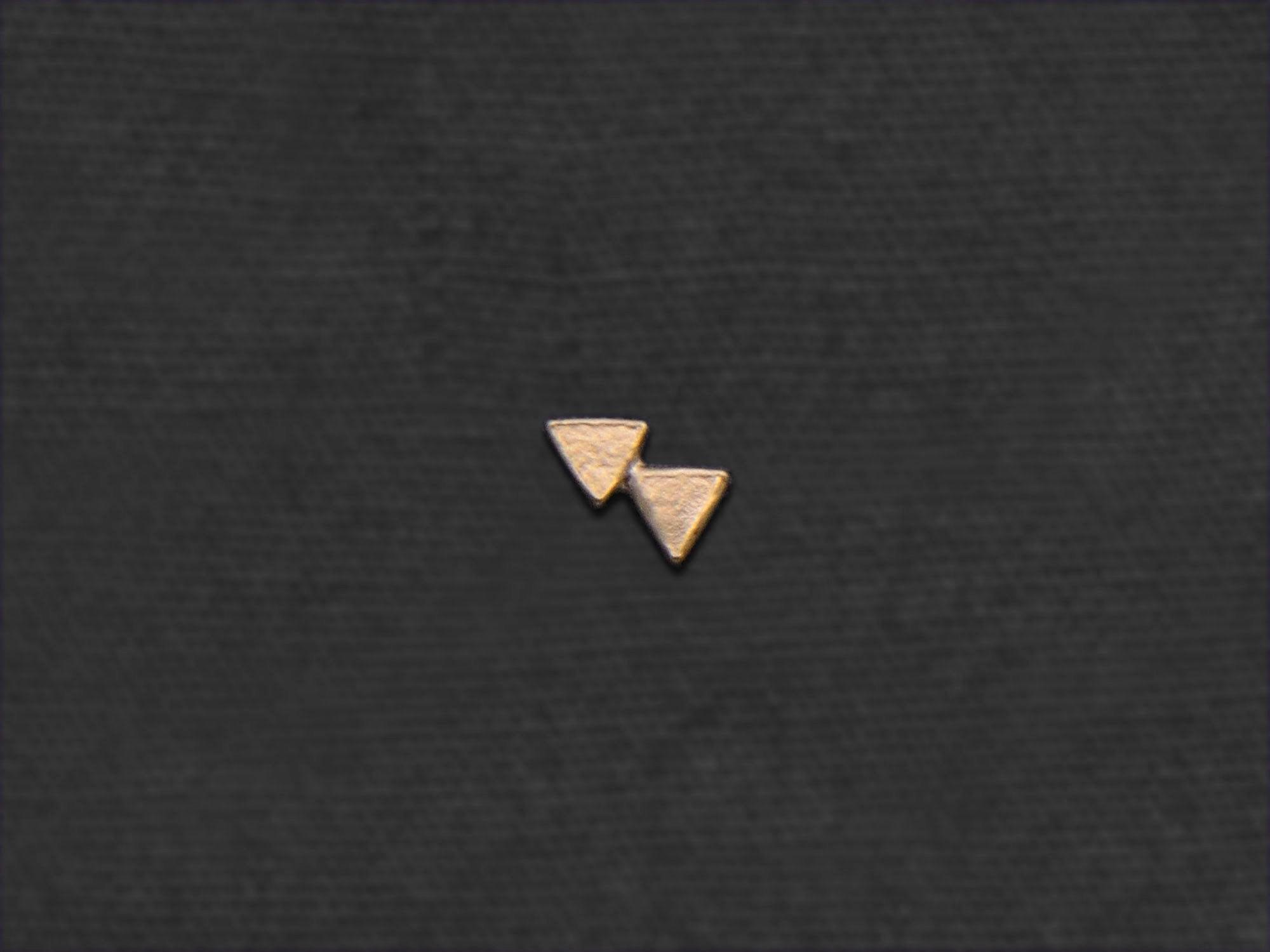 Double Triangle mini stud earring by Emmanuelle Zysman