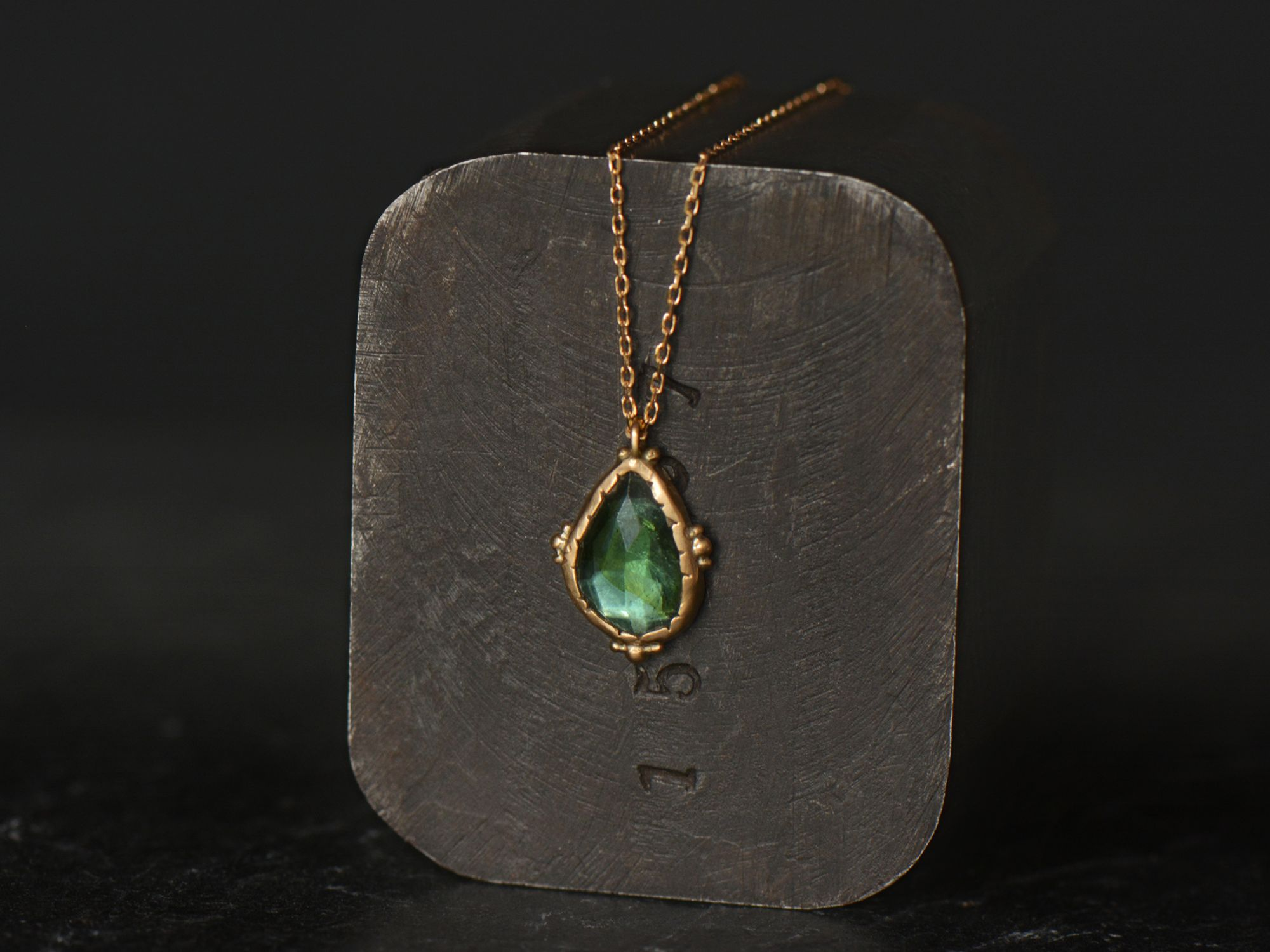 Green rosecut tourmaline and yellow gold Enigma necklace by Emmanuelle Zysman