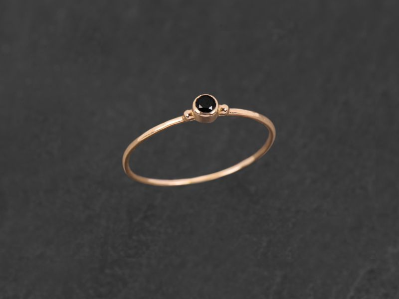 Baby Solitaire pink gold black diamond ring by Emmanuelle Zysman